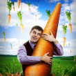 Huge carrot and man — Stock Photo #41012757