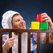 Man in playpen playing — Stock Photo