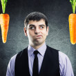 Two carrots and businessman — Stock Photo #41012815