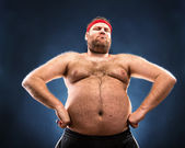 Fat man imitating muscular build — Stock Photo