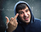Man in hoodie with rude sign — Stock Photo