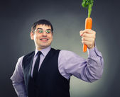 Carrot in hand — Foto de Stock