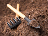 Garden tools on soil — Stock Photo