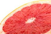 Grapefruit slice on white angle view — Stock Photo