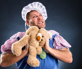 Spiteful man with teddy bear — Stock Photo