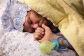Man weared as baby sleeping — Stock Photo