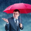Stock Photo: Office worker hiding under umbrella
