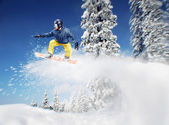 Mountain-skier jump — Stock Photo