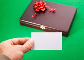Gift box with blank card — Stock Photo