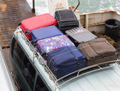 Suitcases on top of car — Stok fotoğraf
