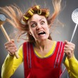Crazy housewife with kitchen tools — Stock Photo #42931613