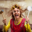 Crazy housewife with kitchen tools — Stock Photo #42931643