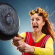 Crazy housewife with pan — Stock Photo