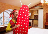 Smiling housewife with ironing-board — Foto de Stock