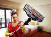Portrait of housewife with vacuum cleaner — Stock Photo