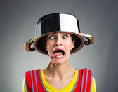 Crazy housewife with sause pan on her head — Stock Photo