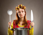 Sad housewife with sause pan  — Stock Photo
