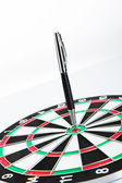 Dart board with pen — Stock Photo