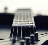 Closeup of electric guitar fretboard with strings — Stock Photo