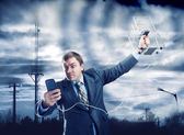 Businessman trying to find signal in storm — Stock Photo