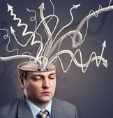 Businessman with arrows in his brain — Stock Photo