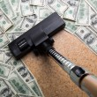 Money on the floor vacuuming with vacuum cleaner — Stock Photo