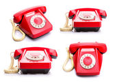Red telephones on white — Stock Photo