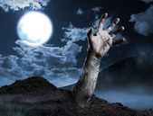 Zombie hand coming out of his grave — Stock Photo