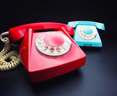 Red and blue telephones — Stock Photo