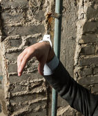 Arrested man with handcuffed hand — Stock Photo