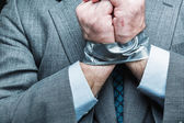 Businessman with hands covered by masking tape — Foto Stock