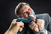 Man with mouth covered by masking tape — Stock Photo