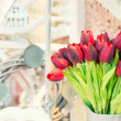 Red tulips in modern living room — Stock Photo