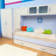 Bright bedroom with a bed and cupboard — Stock Photo #49317789
