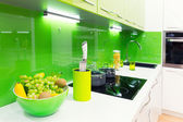Green kitchen interior shot with fruits — Stock Photo