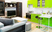 Green kitchen and room clean interior design — Stock Photo