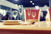 Served fashion table with glases — Stock Photo