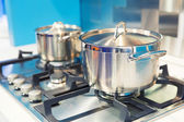 Stove with saucepan on the kitchen — Stock Photo