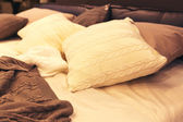 Colorful pillows on hotel bed — Stock Photo