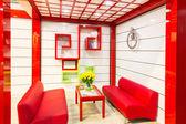Yellow tulips in modern living room — Stockfoto