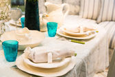 Served fashion table with glases and plates — Stock Photo