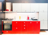 Modern red kitchen interior — Stock Photo