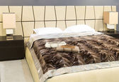 Nice bed in typical contemporary setting — Stock Photo