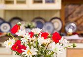 Nice flowers on Luxury kitchen — Stock Photo