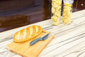 White long loaf on the kitchen — Stock Photo