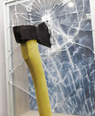 Axe to smash the window — Stock Photo