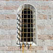 Arched old window — Stock Photo #50796653