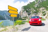 Road signs and car — Stock Photo