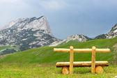 Bench in mountains — Stok fotoğraf