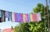 Colorful linen  on rope — Stock Photo